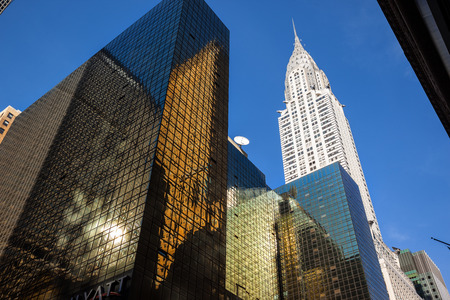 boroughs: NEW YORK, USA - Jun 01, 2014: Chrysler building and manhattan modern architecture. Manhattan is the most densely populated of the five boroughs of New York City