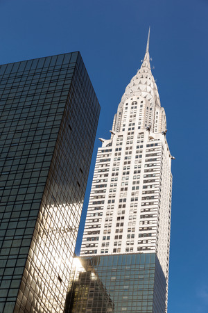 NEW YORK, USA - Jun 01, 2014: Chrysler building and manhattan modern architecture. Manhattan is the most densely populated of the five boroughs of New York City