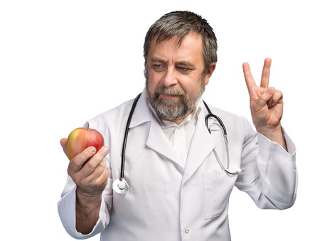 Healthy lifestyles concept. Doctor giving apple for healthy eating and lifestyle or good diet isilated on white Stock Photo