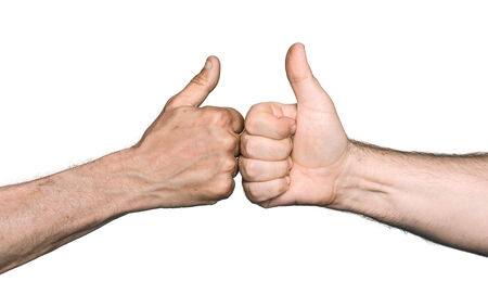 gratified: Body part concept. Two men bumping fists with thumbs up. Isolated on white background
