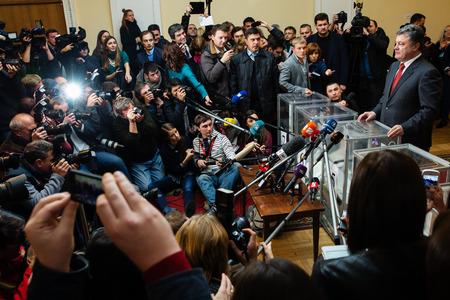 rada: KIEV, UKRAINE - Oct 26, 2014: President of Ukraine Petro Poroshenko voted on early elections to the Verkhovna Rada of Ukraine Editorial