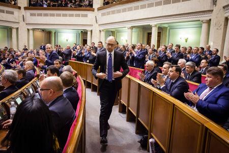 rada: KIEV, UKRAINE - NOV 27, 2014: Ukrainian Prime Minister Arseniy Yatsenyuk at the opening of the first session of the Verkhovna Rada of Ukraine VIII convocation Editorial