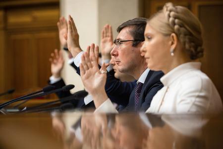 rada: KIEV, UKRAINE - NOV 27, 2014: Peoples deputies of Ukraine Yuriy Lutsenko and Yulia Tymoshenko at the opening of the first session of the Verkhovna Rada of Ukraine VIII convocation