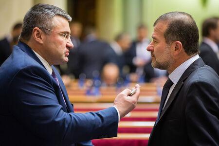 rada: KIEV, UKRAINE - NOV 27, 2014: Peoples deputies of Ukraine Sergey Mishchenko and Viktor Baloga  at the opening of the first session of the Verkhovna Rada of Ukraine