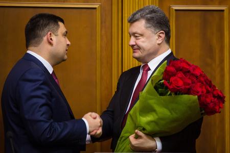 elected: KIEV, UKRAINE - NOV 27, 2014: President of Ukraine Poroshenko congratulates newly elected chairman of the Verkhovna Rada of Ukraine Vladimir Groisman