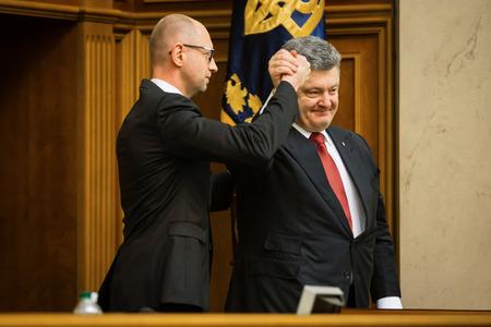 rada: KIEV, UKRAINE - NOV 27, 2014: Ukrainian Prime Minister Arseniy Yatsenyuk and President of Ukraine Petro Poroshenko at the opening of the first session of the Verkhovna Rada of Ukraine VIII convocation
