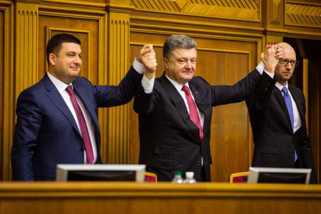 rada: KIEV, UKRAINE - NOV 27, 2014: Chairman of the Verkhovna Rada of Ukraine Vladimir Groisman, president of Ukraine Petro Poroshenko and Ukrainian Prime Minister Arseniy Yatsenyuk Editorial