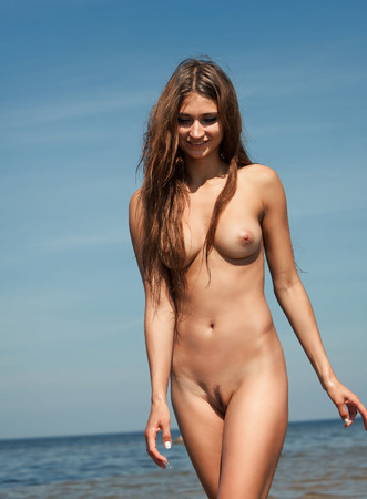 bare breast: Beauty Girl Outdoors enjoying nature. Beautiful young sexy nude woman by the sea. Free Happy Woman. Stock Photo