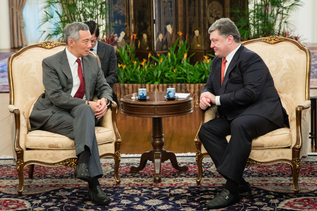 SINGAPORE - DECEMBER 9, 2014: President of Ukraine Petro Poroshenko and Prime Minister of Singapore Lee Hsien Loong during an official meeting during his working visit to the Republic of Singapore