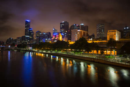 populous: MELBOURNE, AUSTRALIA - DECEMBER 10, 2014: Melbourne skyline along the Yarra River at dusk. Melbourne is the capital and most populous city in the state of Victoria, and the second most populous city in Australia Editorial