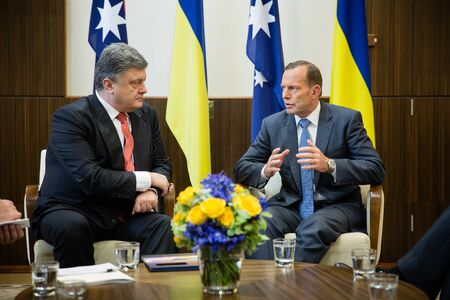 abbott: MELBOURNE, AUSTRALIA - DECEMBER 11, 2014: Australian Prime Minister Tony Abbott during a meeting with the President of Ukraine Petro Poroshenko in Melbourne