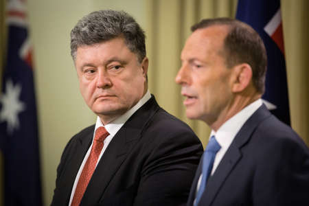 abbott: MELBOURNE, AUSTRALIA - DECEMBER 11, 2014: Australian Prime Minister Tony Abbott during a meeting with the President of Ukraine Petro Poroshenko in Melbourne