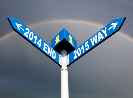 New Year. Street post with 2014 end and 2015 way signs photo