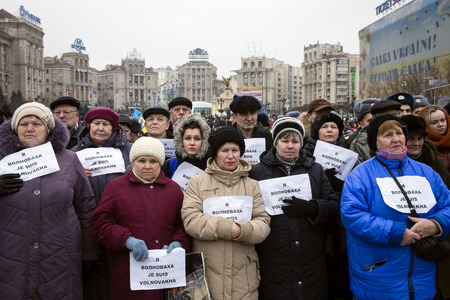affliction: KIEV, UKRAINE - Jan 18, 2015: Banners I Volnovaha and the lamps on Independence Square during the march of solidarity against terrorism and memory of victims of terrorist attack in Volnovakha