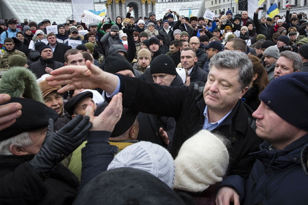 minister of war: KIEV, UKRAINE - Jan 18, 2015: President of Ukraine Poroshenko at the march of solidarity against terrorism and the memory of victims of terrorist attack in Volnovakha, at the Independence Square