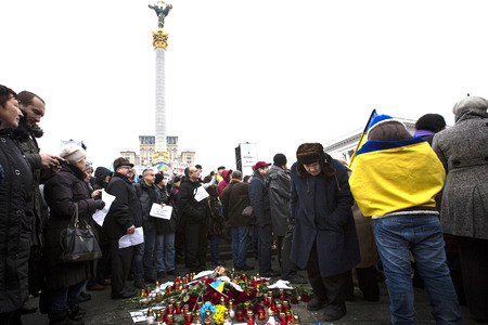minister of war: KIEV, UKRAINE - Jan 18, 2015: Banners I Volnovaha and the lamps on Independence Square during the march of solidarity against terrorism and memory of victims of terrorist attack in Volnovakha