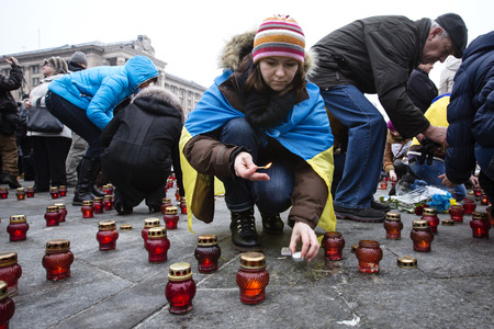 affliction: KIEV, UKRAINE - Jan 18, 2015: Banners I Volnovaha and candles on Independence Square during the march of solidarity against terrorism and memory of victims of terrorist attack in Volnovakha