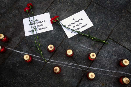 minister of war: KIEV, UKRAINE - Jan 18, 2015: Banners I Volnovaha and candles on Independence Square during the march of solidarity against terrorism and memory of victims of terrorist attack in Volnovakha
