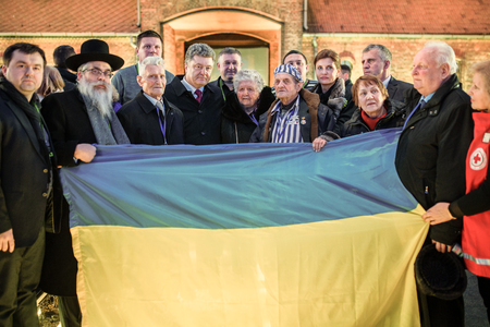 inmates: AUSHWITZ (BIRKENAU), OSWIECIM; POLAND - Jan 27; 2015: Participants of the events to honor the memory of victims of the concentration camp Auschwitz-Birkenau with the President of Ukraine Poroshenko