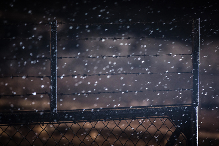 oswiecim: AUSHWITZ (BIRKENAU), OSWIECIM; POLAND - Jan 27; 2015: Barbed wire fences of the concentration camp Oswiecim Birkenau