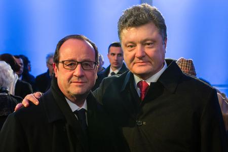 oswiecim: AUSHWITZ, OSWIECIM; POLAND - Jan 27; 2015: President of Ukraine Poroshenko and French President Francois Hollande during events dedicated 70th anniversary of the liberation of Auschwitz-Birkenau