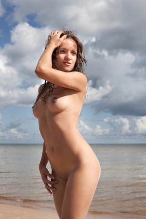 beach breast: Beauty girl outdoors enjoying nature. Young naked woman on the beach Stock Photo