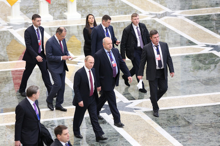 Delegation: MINSK, BELARUS - Feb 12, 2015: Russian President Vladimir Putin and the Russian delegation after the talks of leaders of in the Norman format in Minsk Editorial
