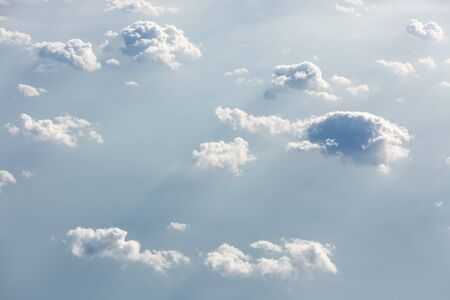 Beautiful sky with clouds, a view from an aeroplane above the clouds Stock Photo