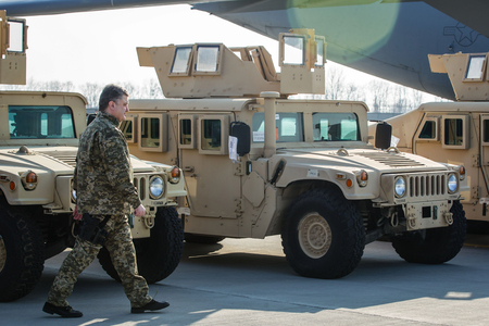 KIEV, UKRAINE - Mar. 25, 2015: President of Ukraine Poroshenko inspects vehicles HMMWV (Humvee) during a meeting of the aircraft of the US Air Forces with the first batch of American armored vehicles