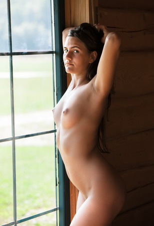 Morning portrait of a young naked woman in the camping photo