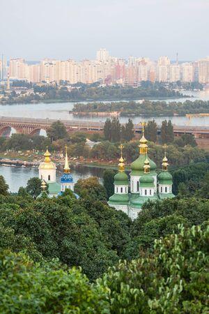 kiev: Panorama of the city Kiev. Ukraine. Monastery Vydubitsky. The Dnieper River and new buildings in Kiev