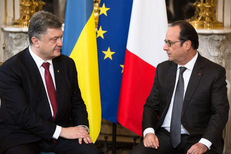 intercourse: PARIS, FRANCE - Apr 22, 2015: President of Ukraine Petro Poroshenko and French President Francois Hollande during an official meeting in Paris