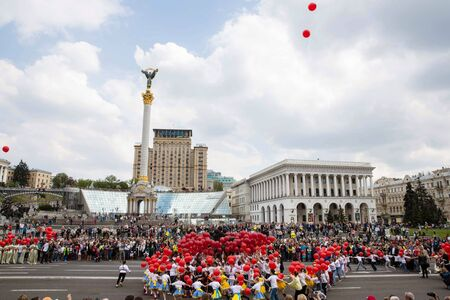 joyfulness: KIEV, UKRAINE - May. 01, 2015: Flashmob Poppies of memory on Independence Square in Kyiv