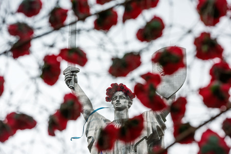 reconciliation: KIEV, UKRAINE - May. 08, 2015: Poppies of memory. The monument Mother Motherland decorated with a wreath of poppies on the Day of Remembrance and Reconciliation in Kiev