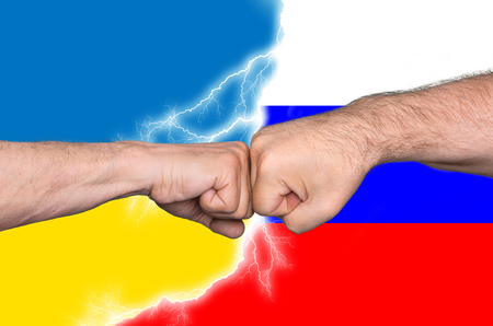 imperialism: Political metaphor. Russian Ukrainian conflict. Two men bumping fists Stock Photo