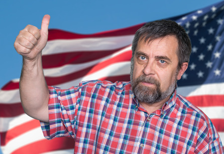 gratified: Patriotic concept. Middle-aged man tumb up against of United States of America flag