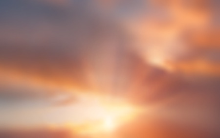 sunrays: Blurred sunset cloudy sky background with sunrays Stock Photo