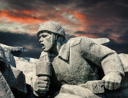 communists: Soviet era WW2 memorial in Kiev Ukraine against dramatic sky background