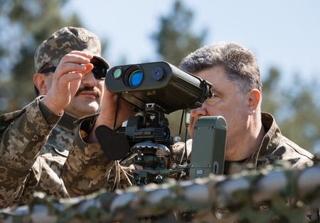 reg: CHERNIHIV REG, UKRAINE - May. 11, 2015: President of Ukraine Petro Poroshenko, examines the latest weapons in the Ukrainian army training center of the Land Forces of the Armed Forces Desna
