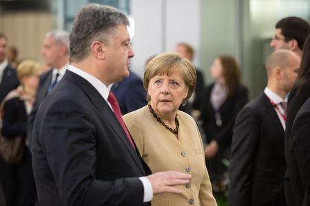 chancellor: RIGA, LATVIA - May 22, 2015: Eastern Partnership Sammit. President of Ukraine Petro Poroshenko communicate with Chancellor of the Federal Republic of Germany Angela Merkel Editorial