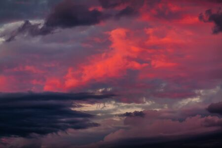 moody: Abstract nature background. Dramatic and moody pink, purple and blue cloudy sunset sky Stock Photo