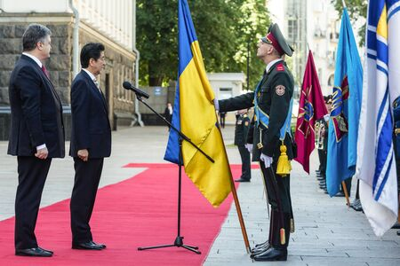 abe: KIEV, UKRAINE - Jun 06, 2015: Japanese Prime Minister Shinzo Abe during his meeting with President of Ukraine Petro Poroshenko in Kiev. Guard of Honour Editorial