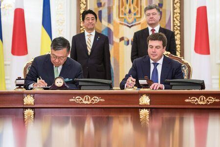 abe: KIEV, UKRAINE - Jun 06, 2015: President of Ukraine Petro Poroshenko and Japanese Prime Minister Shinzo Abe during the signing of Ukrainian-Japanese documents