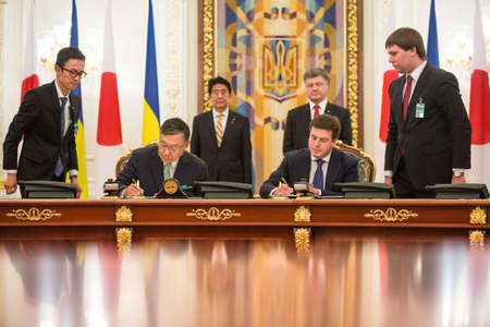 abe: KIEV, UKRAINE - Jun 06, 2015: President of Ukraine Petro Poroshenko and Japanese Prime Minister Shinzo Abe during the signing of Ukrainian-Japanese documents