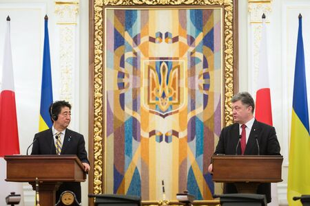 abe: KIEV, UKRAINE - Jun 06, 2015: President of Ukraine Petro Poroshenko and Japanese Prime Minister Shinzo Abe during a joint briefing in Kiev