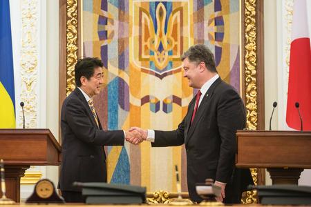abe: KIEV, UKRAINE - Jun 06, 2015: President of Ukraine Petro Poroshenko and Japanese Prime Minister Shinzo Abe during a joint briefing in Kiev