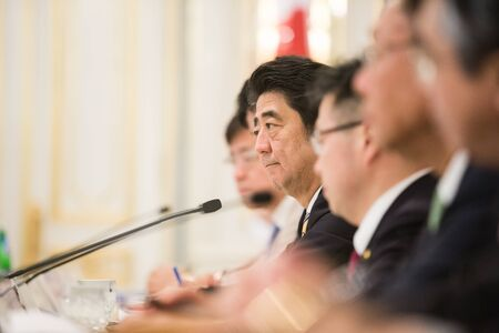 abe: KIEV, UKRAINE - Jun 06, 2015: Japanese Prime Minister Shinzo Abe during his meeting with President of Ukraine Petro Poroshenko in Kiev Editorial