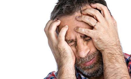 ail: Headache. Portrait of an middle age man with face closed by hand. Isolated on white with copy-space Stock Photo