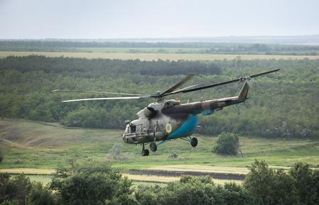 reg: DONETSK REG, UKRAINE - Jun 11, 2015: Ukrainian military helicopter in flight on combat duty in the area of the antiterrorist operation