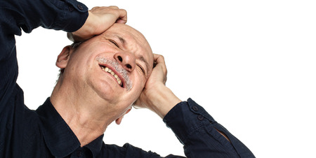 Elderly man suffering from a headache isolated on white background with copy-space